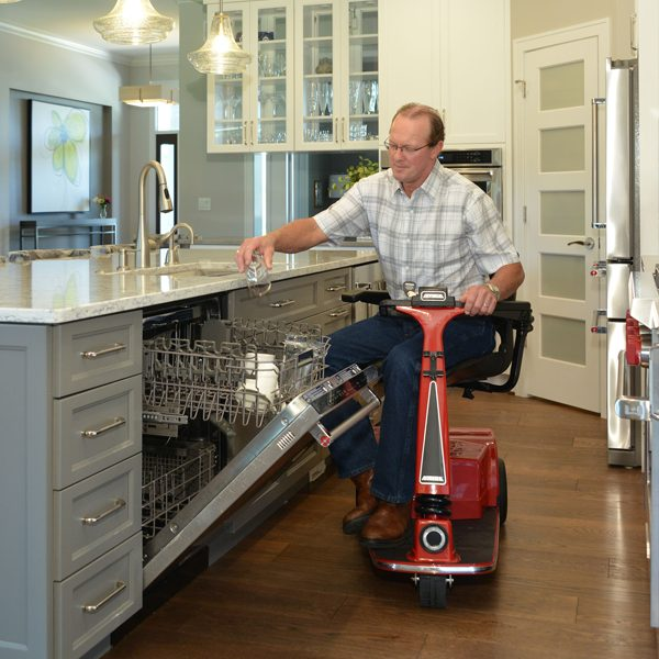 amigo_mobility_rtx_personal_electric_scooter_in_home_senior_care_facility_washing_dishes