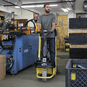 Amigo mobility dex personnel carrier tugger cart navigating through tight aisle