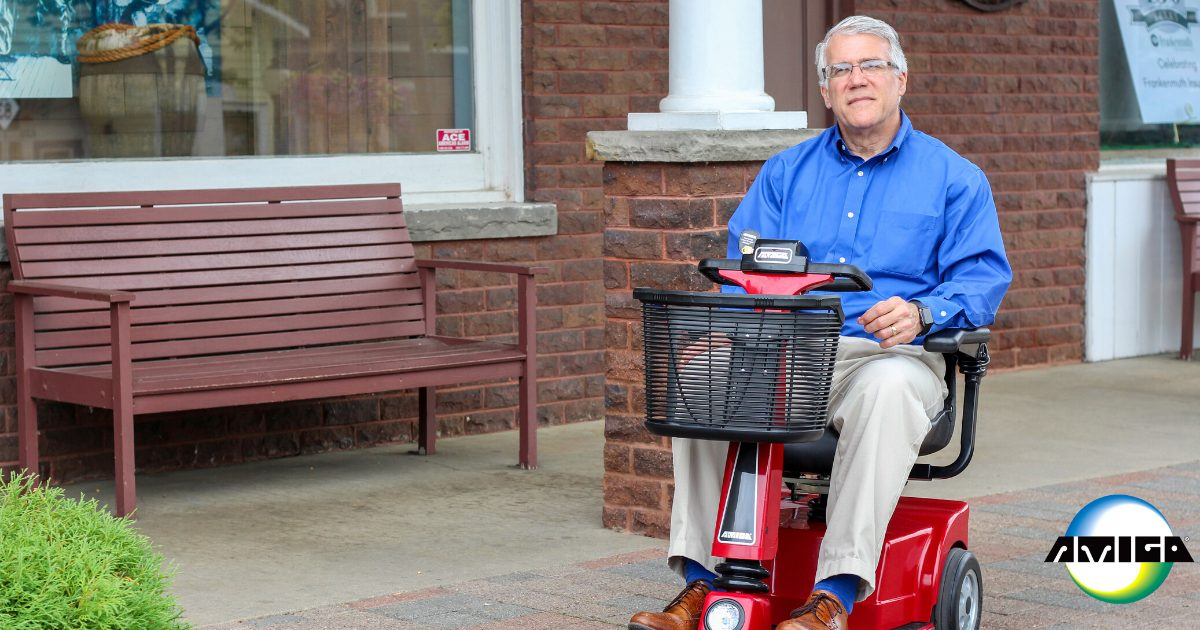 Male Amigo RD user sitting on front porch